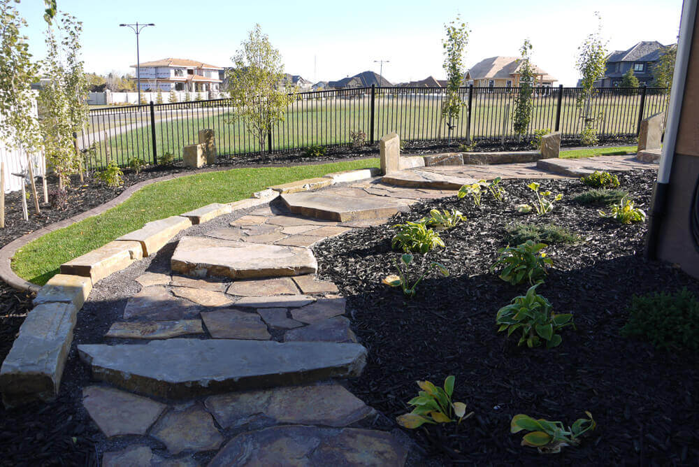 Edmonton landscaping services lotus bobcat service for Landscaping services